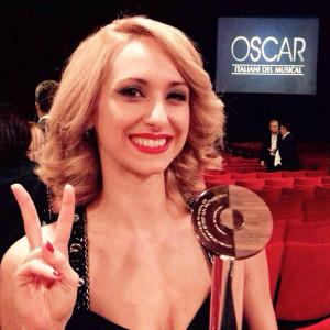 Valentina Gullace al riceve il premio OIM